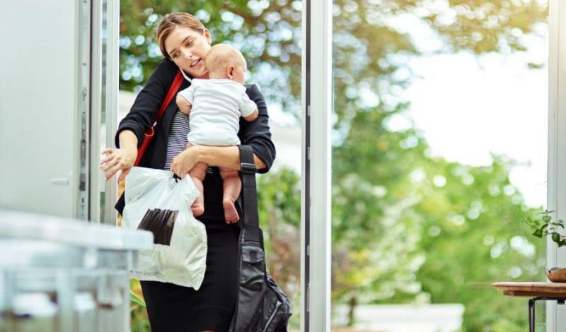 Mum carrying baby and bags